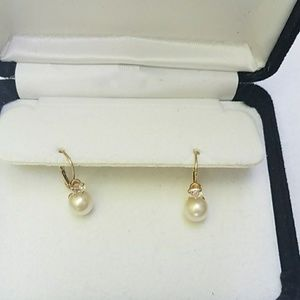 Gold CZ real pearl earrings.